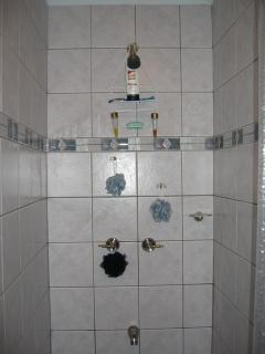 Full size shower with hot water on demand