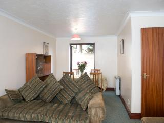 Flat 1 lounge with double doors out to garden