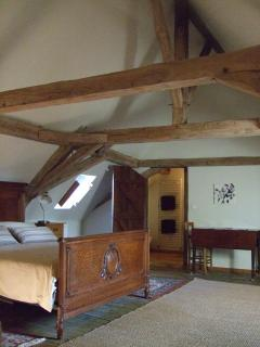Master bedroom,oak beams, antique French walnut bed ,en-suite toilet/shower and dressing room