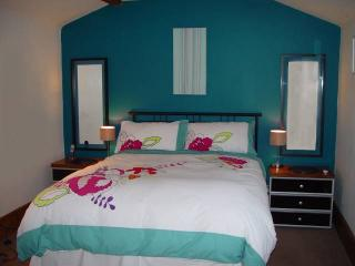 The Den - double bedroom with large fitted wardrobe, bedside cabinet, mirrors. SKY TV