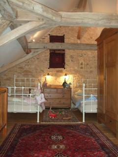 Twin bedroom,Cot, en-suite with toilet and shoer room,, fabulous beams