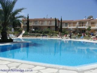One of the pools, our villa is the 1st one you see at the end of the path