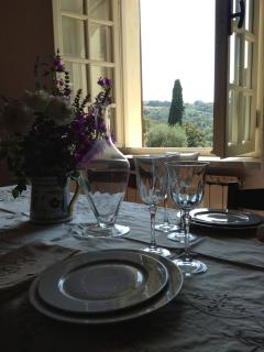 Dining room looks out over the cypresses and rolling hills