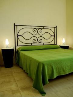 Green double bedroom