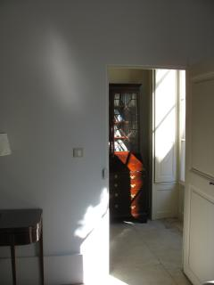 Looking From Sitting Room into Bedroom with secretaire bookcase suitable for writing or working