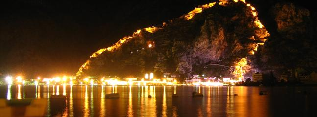 See Kotor's ramparts by night from your balcony