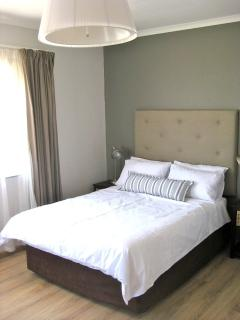 Second bedroom with percale cotton linen, stylishly designed with built in cupboards