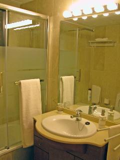 Full bathroom with glass shower screen