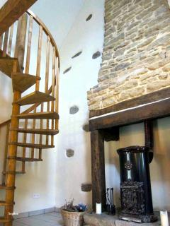 The spiral staircase and old stove fire in the original fireplace