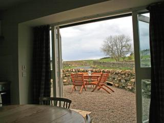 Looking out to the private outside area and the fields beyond