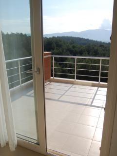 The balcony off the main bedroom on the top floor gives fantastic views of the forest