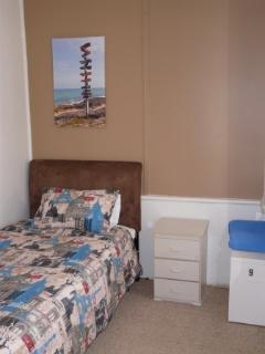 Comfortable and private King Single Bedroom, night stand, locker, desk.  Enquire about price.