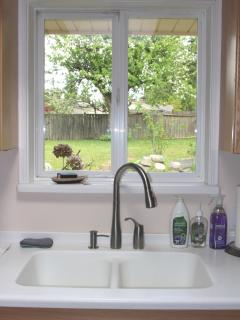 Pastoral view to backyard- seamless corian sinks