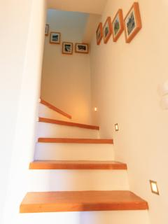 LED lit staircase up to Master Bedroom