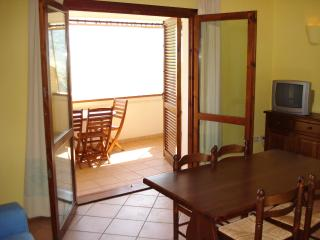 LIVING ROOM OPENING OUT TO BALCONY