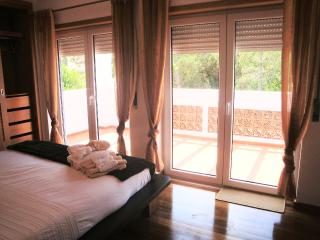 luxury bedroom with unsuite and large varanda! With the view of pine trees.!! It's so private!!