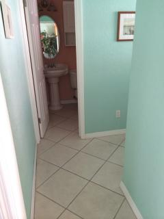 hallway looking into bathroom