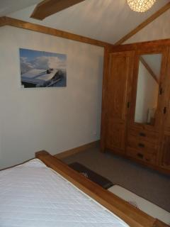 Another view of bedroom upstairs with double bed and large oak wardrobe