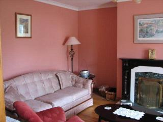 Sofa and fireplace in sitting-room.  CD, Sat TV, DVD,                                    ,   DWR
