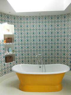 Bateaux style bath, with sky-light above.