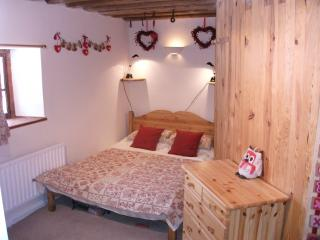 upstairs red double bedroom with ensuite shower room
