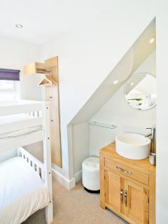 Room with bunk beds- all have vanity units