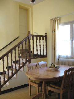 Dining room stairs lead to bedroom
