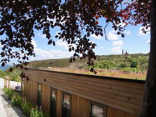 Treth House Has a Sedum Roof and Looks Towards the Sea