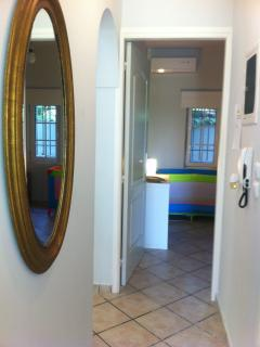 The corridor which joins the 2 bedrooms and the main bathroom.
