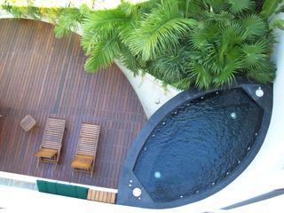 Tropical Garden on Main floor with Black Granite Jacuzzi