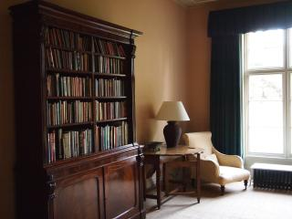 A selection of books and games available in the sitting room