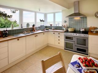 The large, fully equipped kitchen has fantastic sea views - concentrating on cooking's tricky!