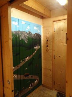 entrance with hand-painted Swiss mountain scene