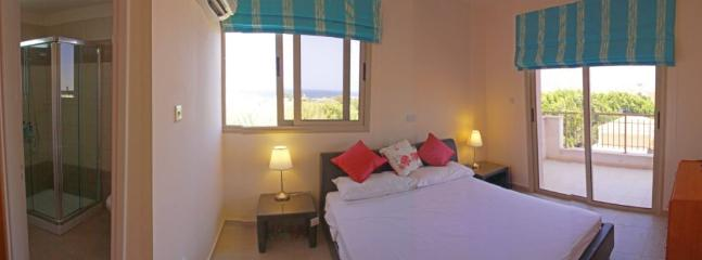 Master bedroom with sea view and large balcony overlooking the pool