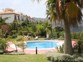 shared swimming pool set in beautiful gardens