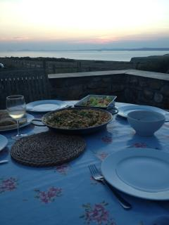 Dining on the terrace overlooking the sea at The Old Granary.
