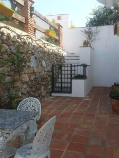back terrace -  secure gate to pool. cool in morning, hot afternoon then cool again. Ga