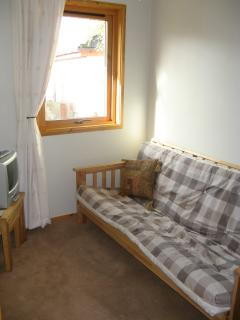 Study with futon for quiet space or extra double bed