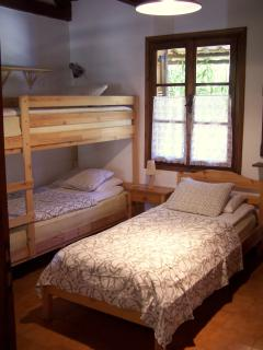 Bedroom with single bed and bunk bed perfect for children.