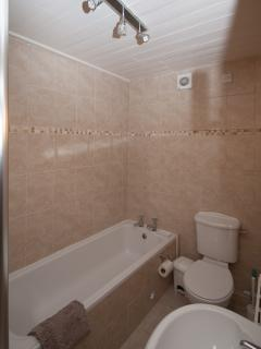 Bathroom which also has walk in shower