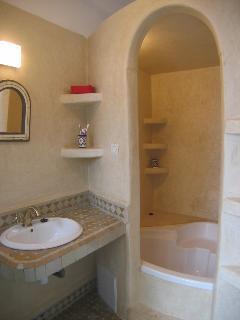 Bathroom with double bath/shower.