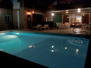 By Night, your PRIVATE ROOFTOP POOL and BBQ/dining area. Direct access from the lounge/ living area.