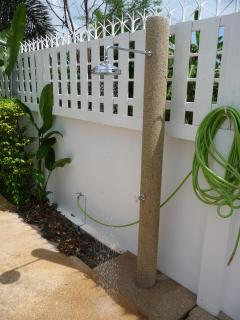 Outdoor shower, wheelchair accessible.