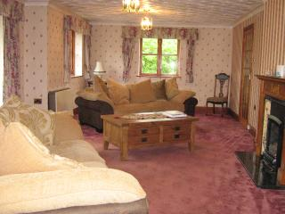 Living room; plenty of space, 2 large sofas, TV and DVD player, piano, doors to patio and garden