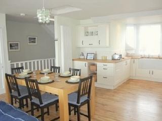 Spacious bright kitchen dining, Lounge area and  w.c on upper floor all have spectacular sea views