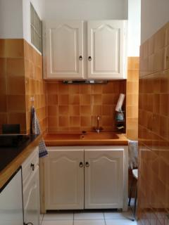 ...a kitchen that is sleek and well-stocked with cook's tools...