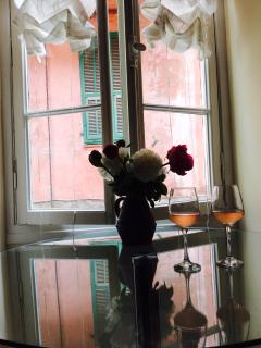 the table by the window is the perfect place to enjoy morning coffee and afternoon wine