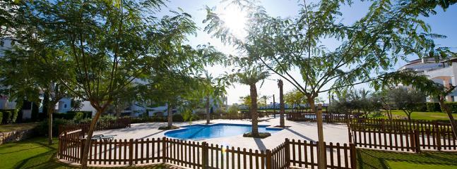 Beautiful pools in gardens below apartment, plenty of shade if needed.