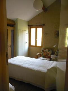 Twin bedroom, view onto pasture and small stream