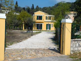 Main entrance of the property and private road leads to the villa